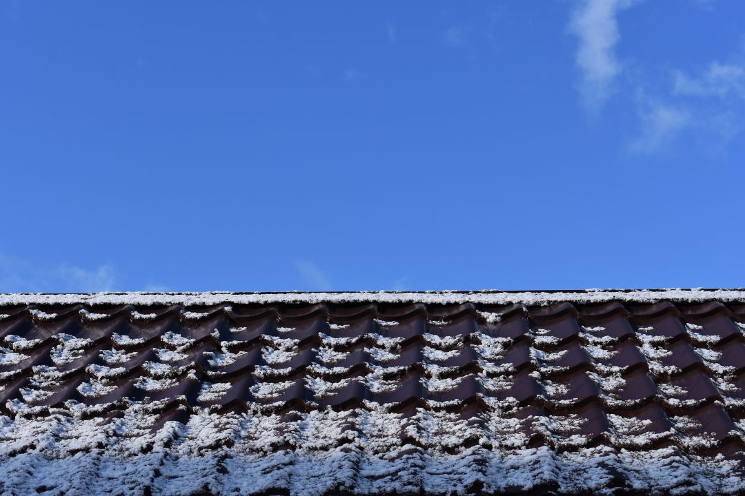 a frosty roof thaws in the sun